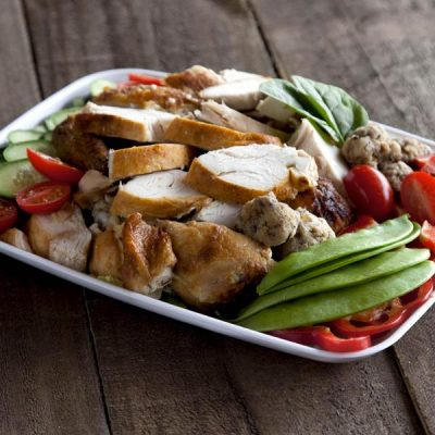 Platter of chicken pieces and vegetables